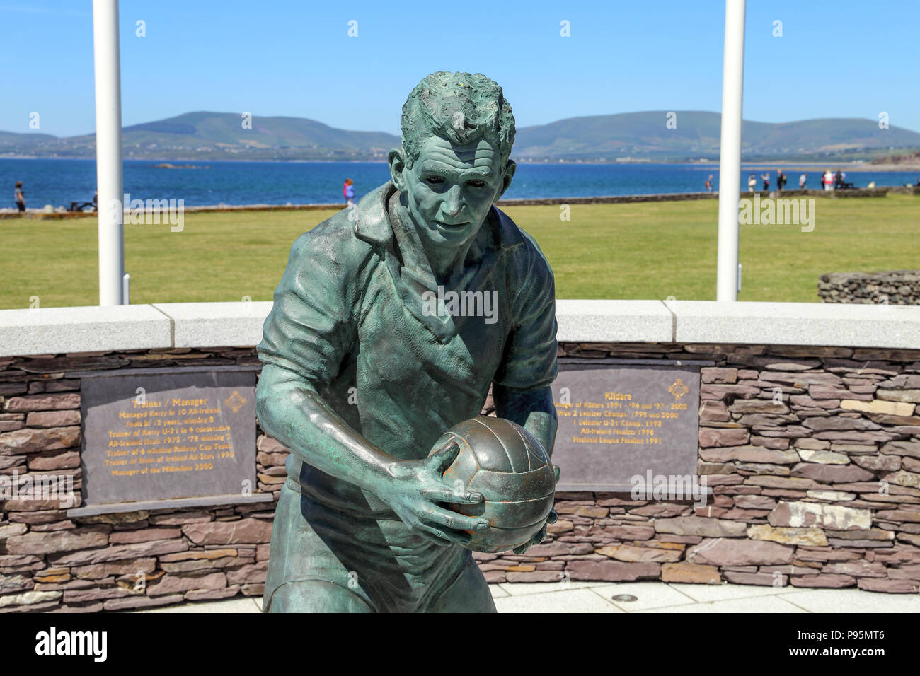 The bronze statue of famed Gaelic footballer and coach Mike O'Dwyer on the waterfront of waterville, Ireland, County Kerry. - Stock Image