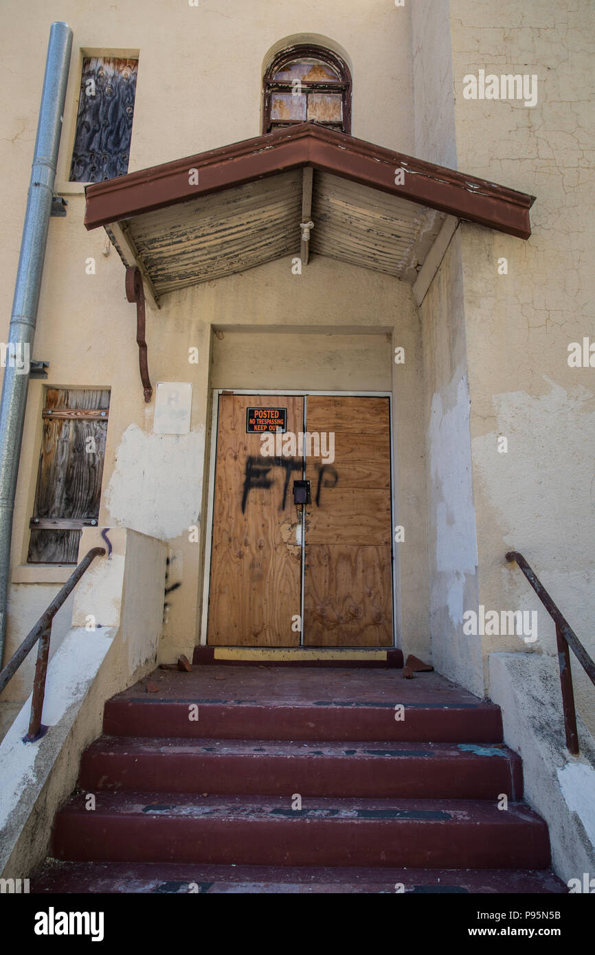 The old, boarded up door of an abandoned building in the