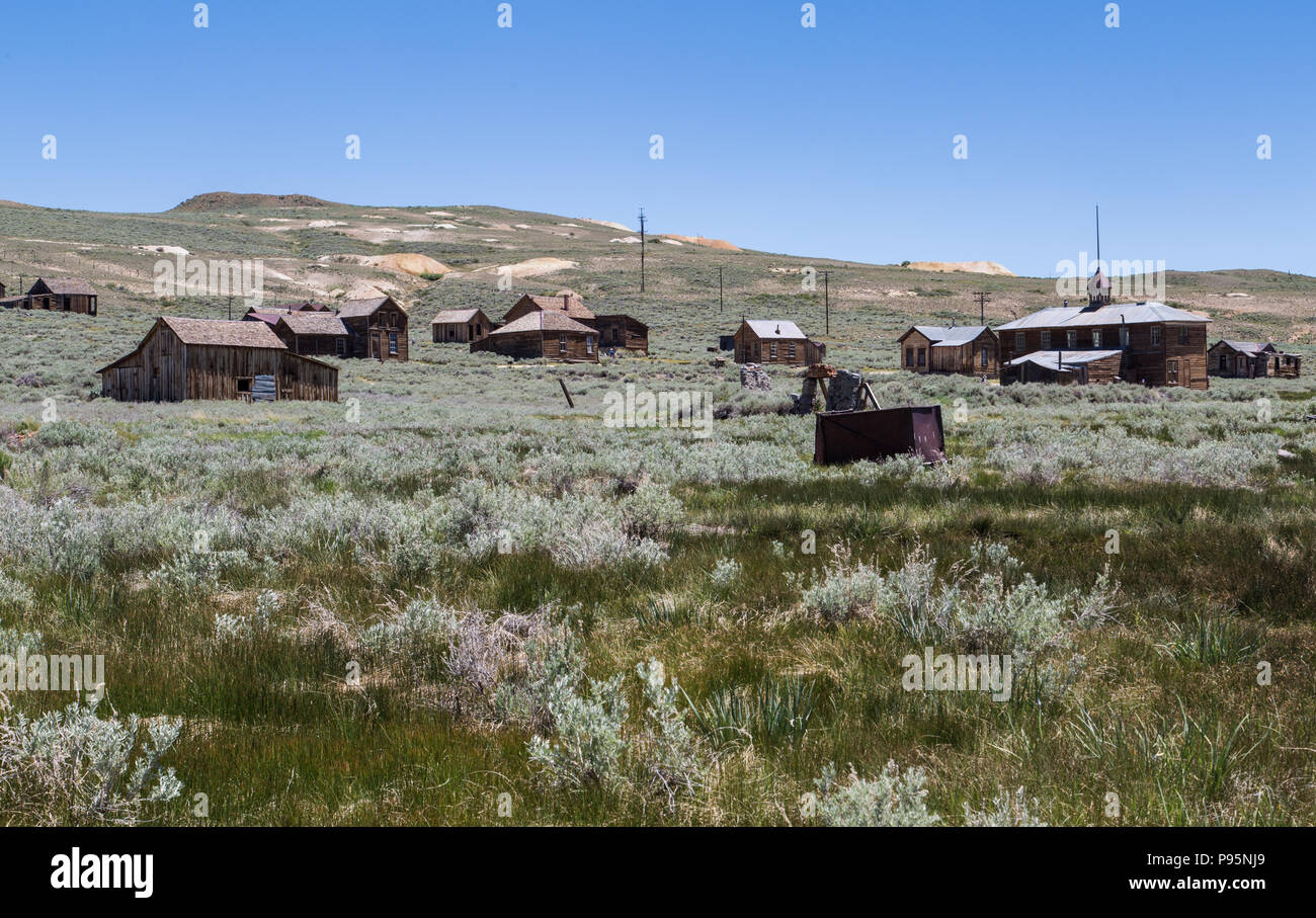 A view of the abandoned historic town of Bodie, California nestled on a hill. The town is now a State Park. - Stock Image