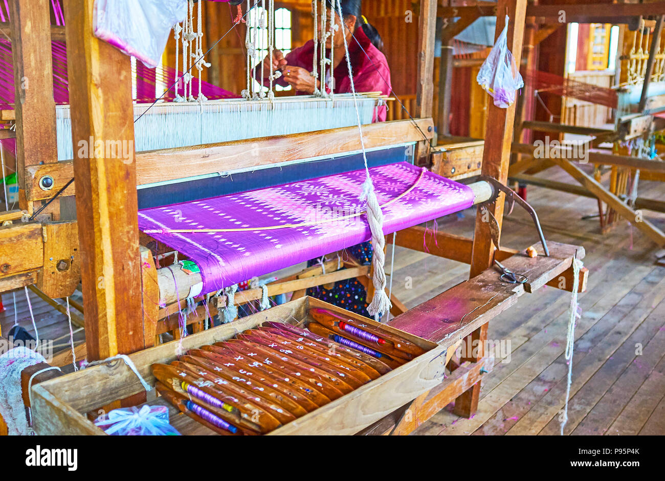 INPAWKHON, MYANMAR - FEBRUARY 18, 2018: Handmade textile production is one of the main handicrafts on Inle Lake, local workshops offer silk and cotton - Stock Image