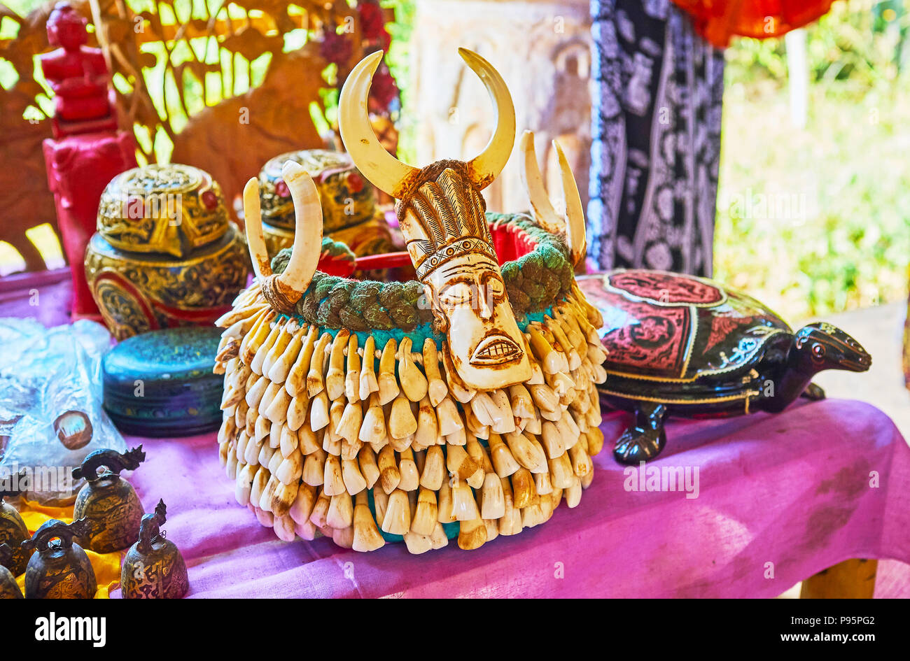 The tribal male headdress, decorated with animals' teeth is one of the most unusual gifts from Myanmar, Inn Thein (Indein) village on Inle Lake. - Stock Image