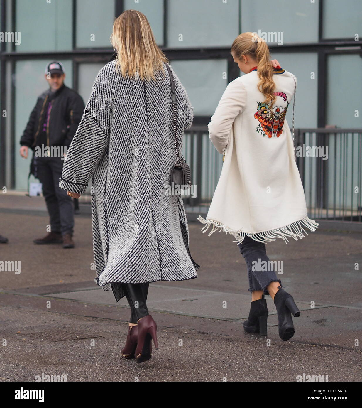 MILAN - FEBRUARY 22, 2018:Models, fashion blogger and celebrities in the street before and after LES COPINS fashion show, during MFW 2018 - Stock Image