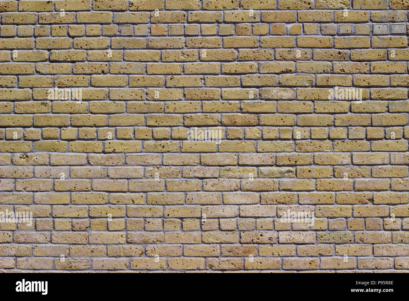 4857e72ce83242 Rustic old white beige brick wall background in common bond pattern with  grunge look - Stock