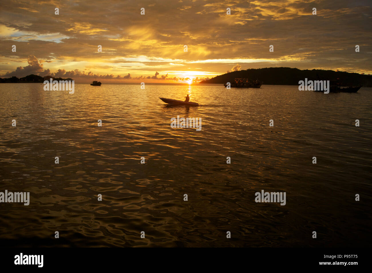 sunset over the south china sea - Stock Image