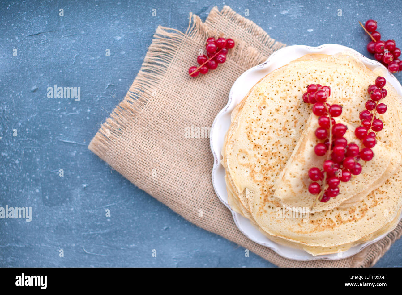 Thin sweet pancakes. traditional Russian food in the spring. Festive treat. Homemade breakfast. Free space for text or a postcard - Stock Image