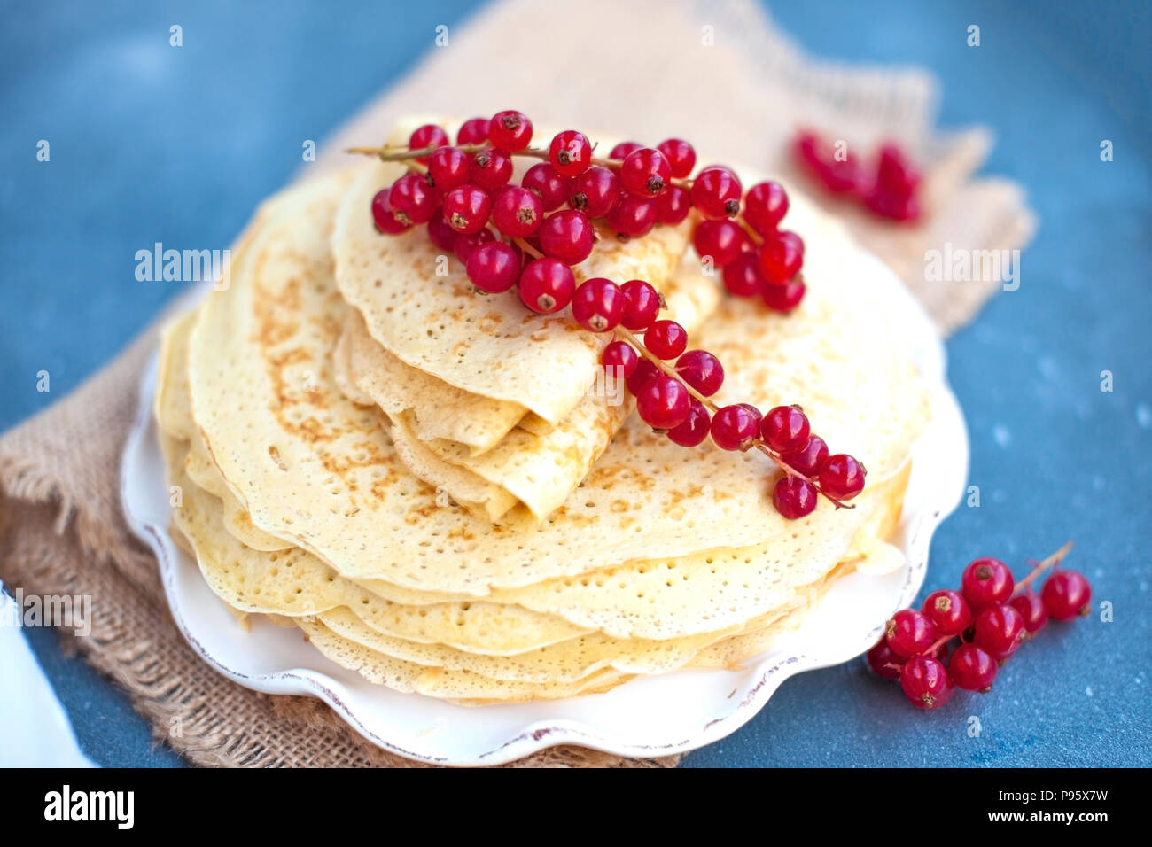 Thin sweet pancakes. traditional Russian food in the spring. Festive treat. Homemade breakfast. Free space for text or a postcard. - Stock Image
