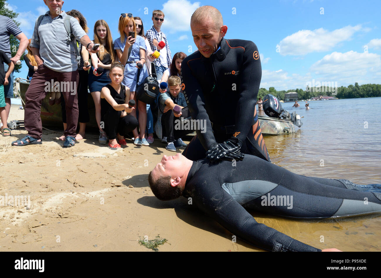 Lifeguards demonstrate right ways of artificial respiration for drowning. - Stock Image