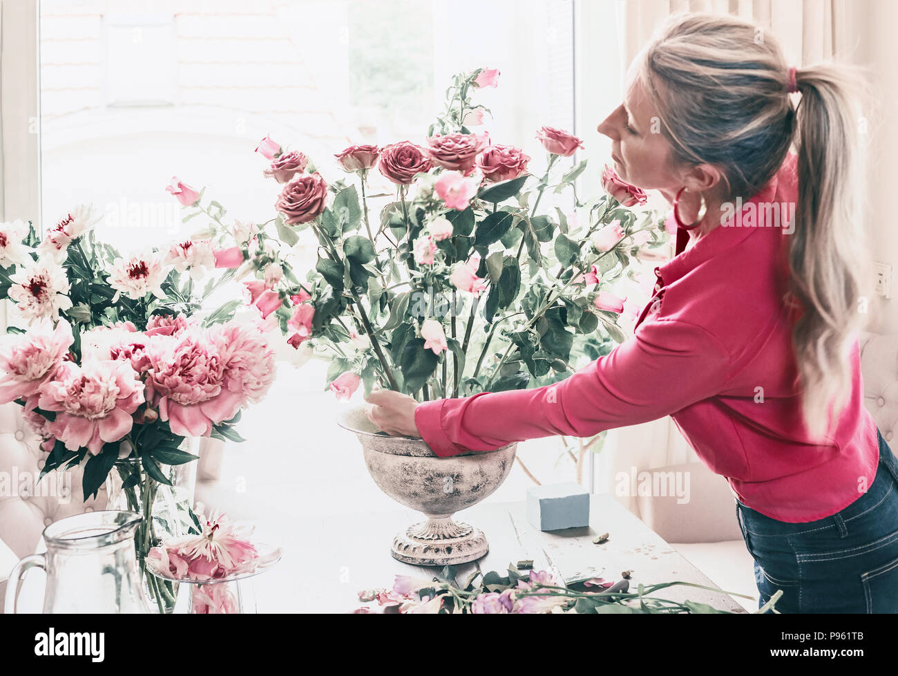 Florist Women In Red Shirt Make Beautiful Big Festive Event Classical Bouquet With Roses And Other Flowers In Urn Vase On Table At Window Lifestyle Stock Photo Alamy