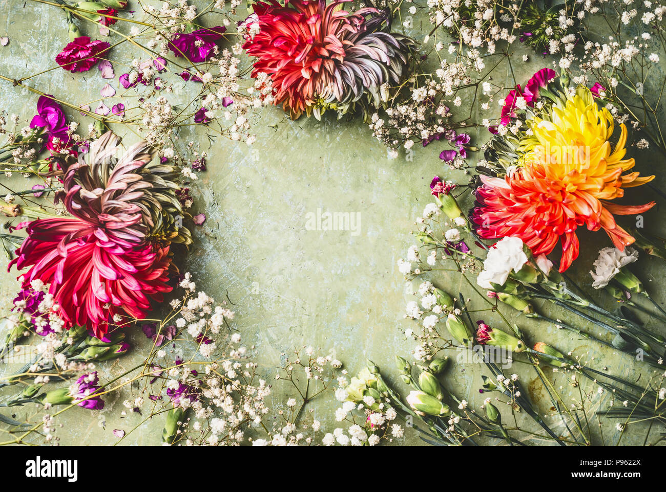Pretty Summer Garden Flowers Frame On Green Background Top View