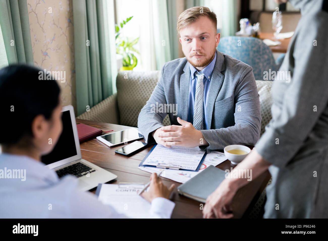 Businessman at meeting - Stock Image