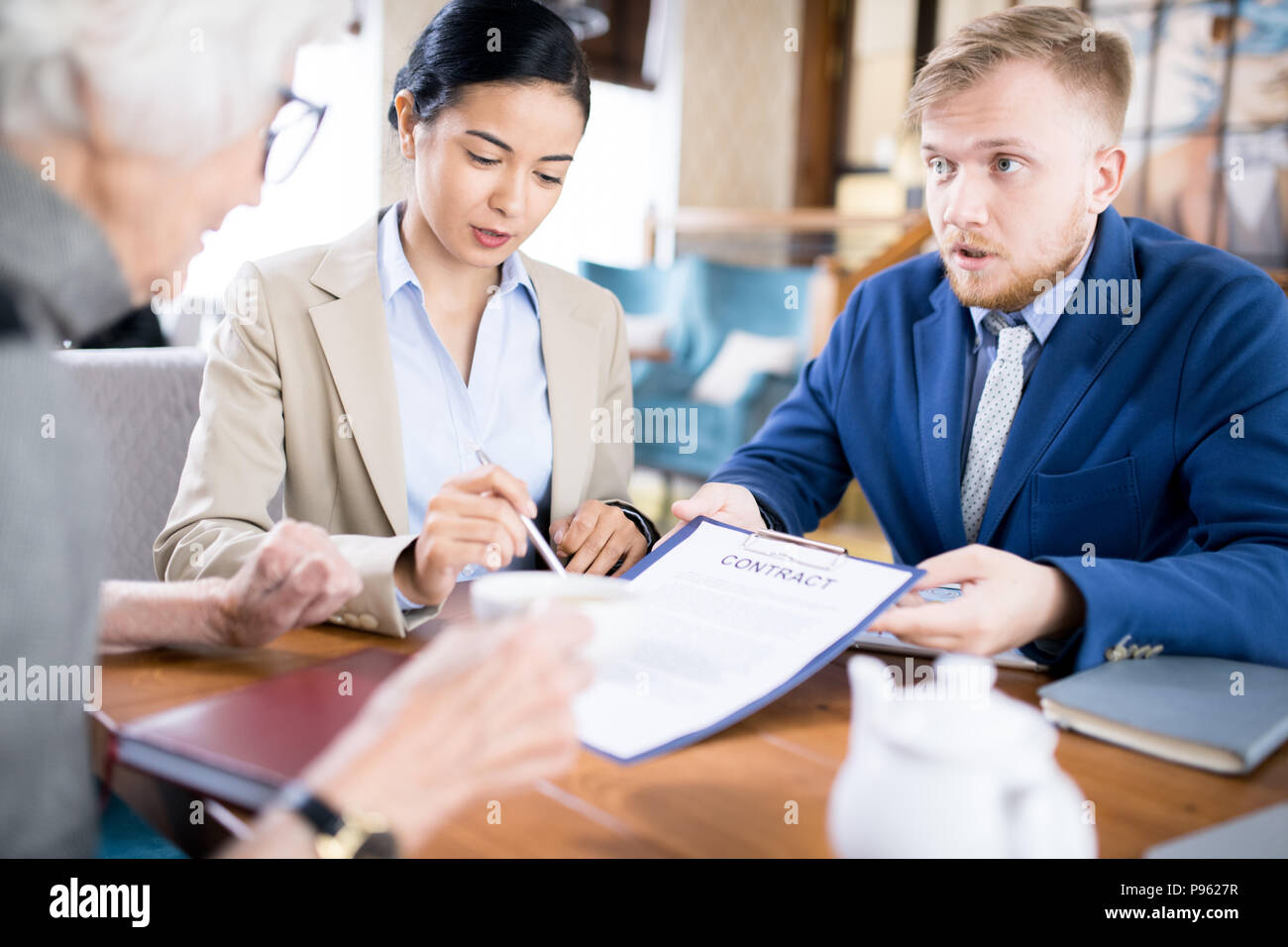 Business contract for elderly - Stock Image