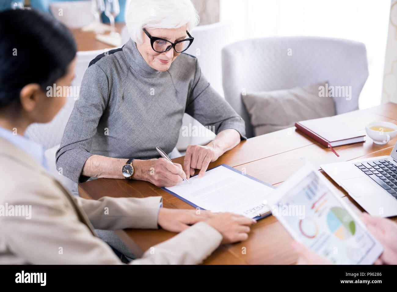 Senior woman writing testament - Stock Image
