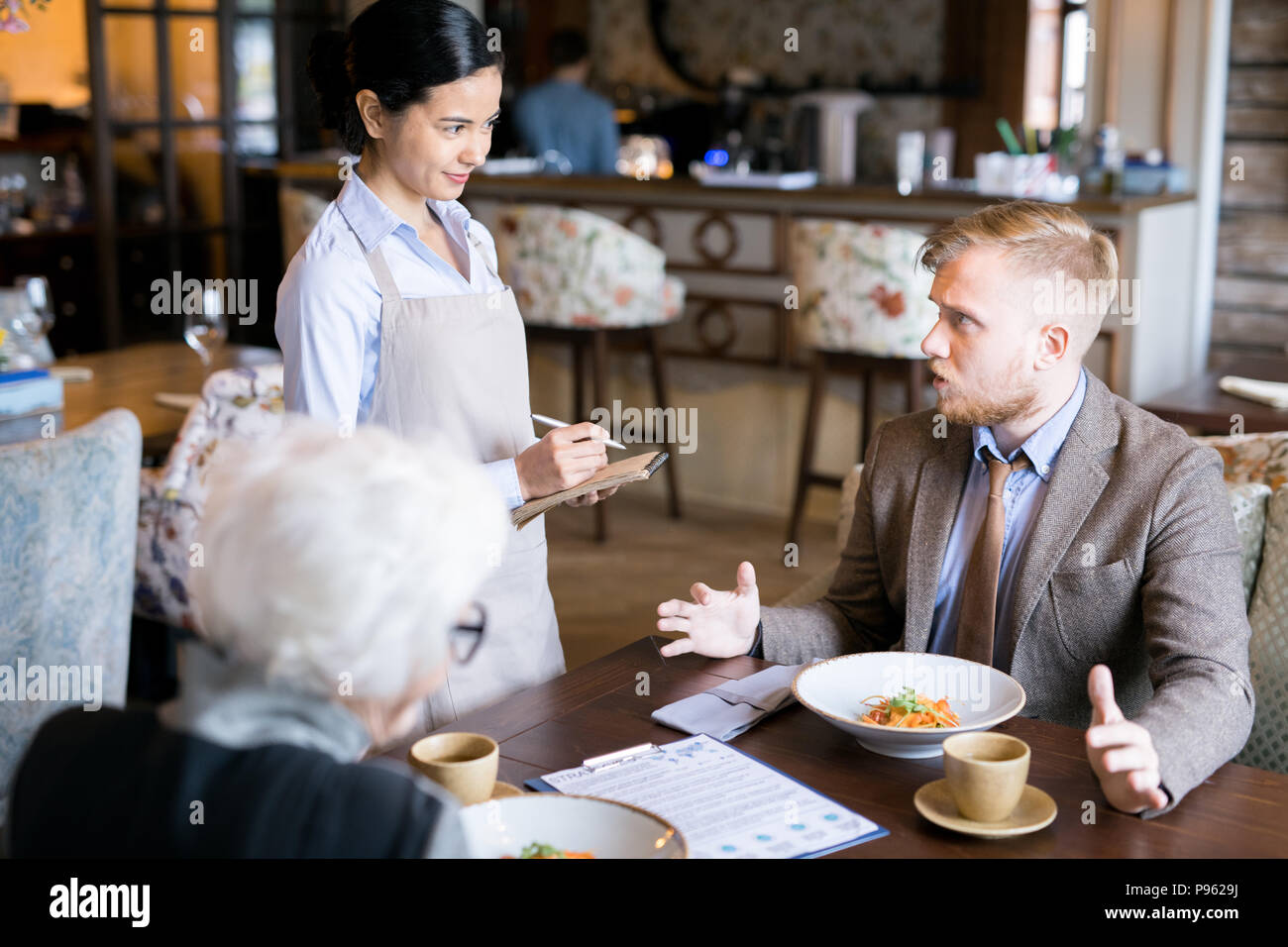Business lunch at cafe - Stock Image