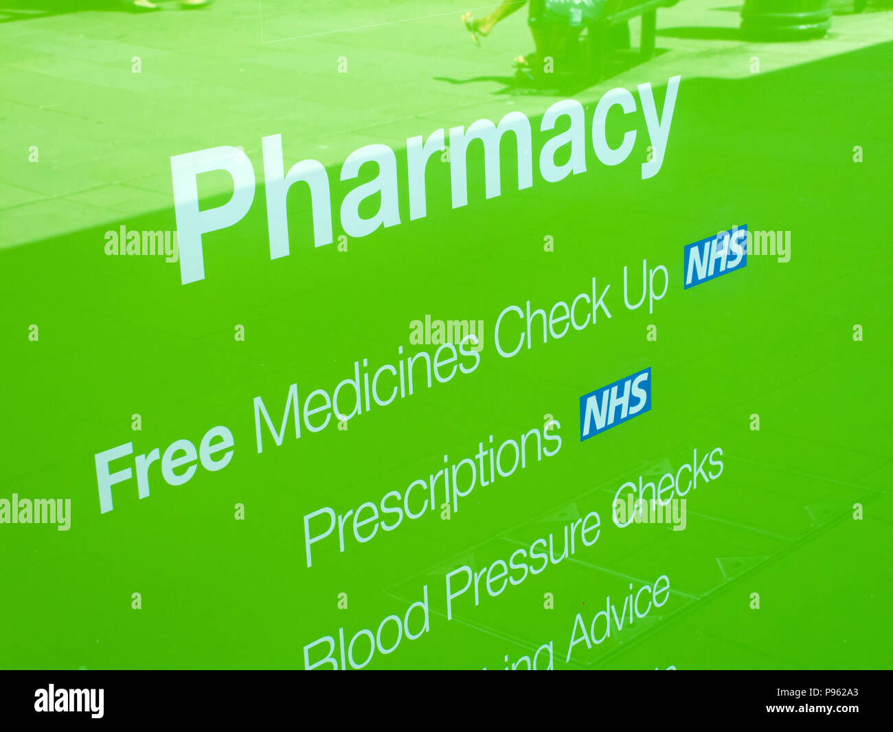 NHS, National Health Service prescriptions sign in pharmacy shop window - Stock Image