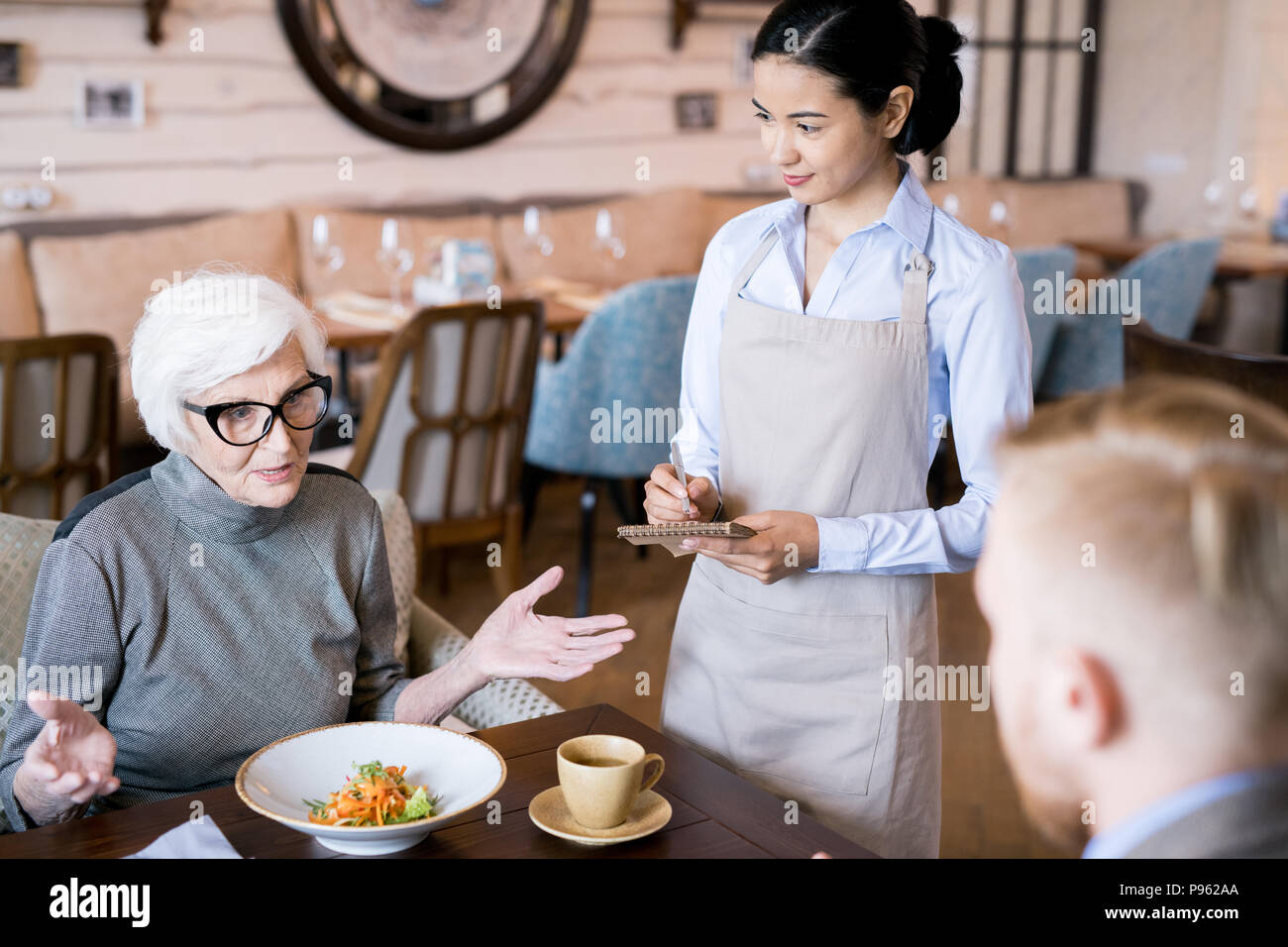 Family dinner at the restaurant - Stock Image