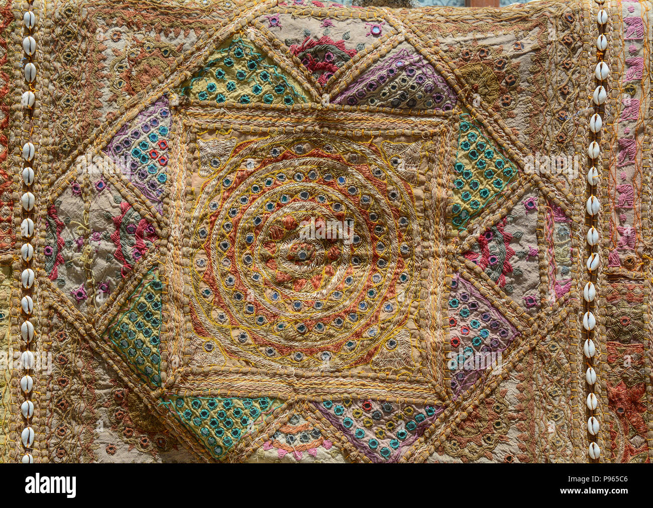 Precious ancient carpet for sale at street market in Leh, India. - Stock Image