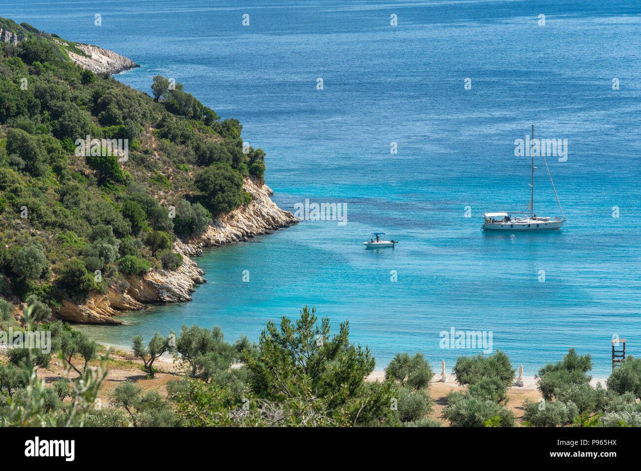 Yacht at anchor at Filiatro beach. On the East coast of the  island of Ithaca, Ionian Sea, Greece Stock Photo