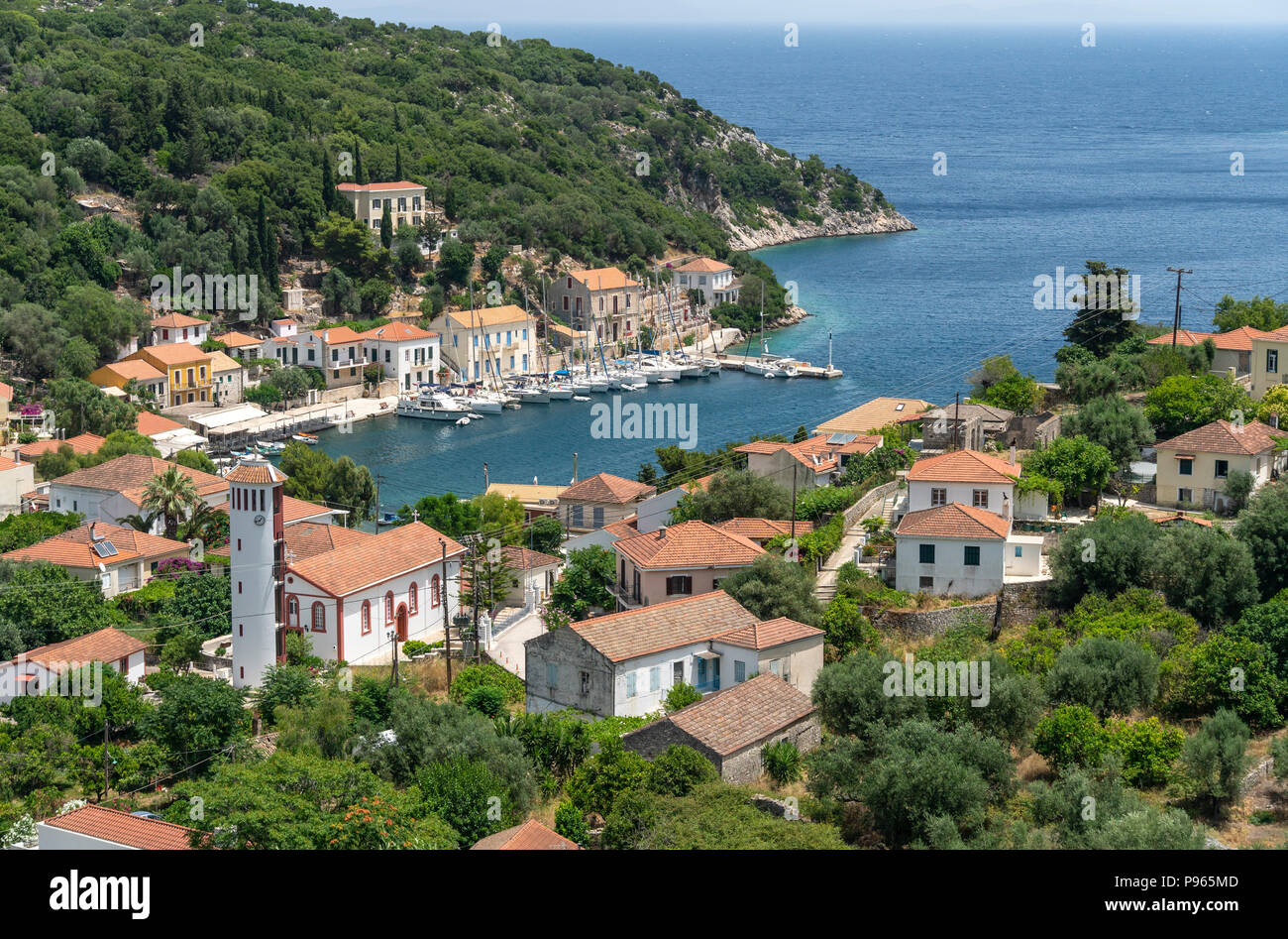 Looking down on the village and harbour of Kioni on the north eastern side of the island of Ithaca, Ionian Sea, Greece - Stock Image