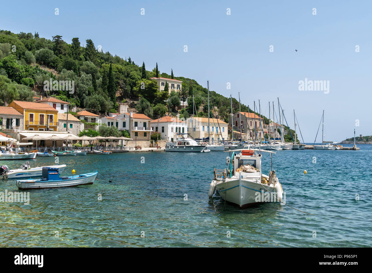 Fishing boats in the harbour at the village of Kioni on the north eastern side of the island of Ithaca, Ionian Sea, Greece - Stock Image