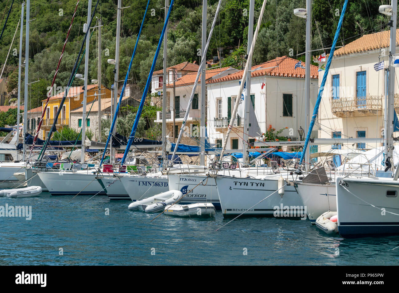 Yachts moored along the quay in the harbour at the village of Kioni on the north eastern side of the island of Ithaca, Ionian Sea, Greece Stock Photo