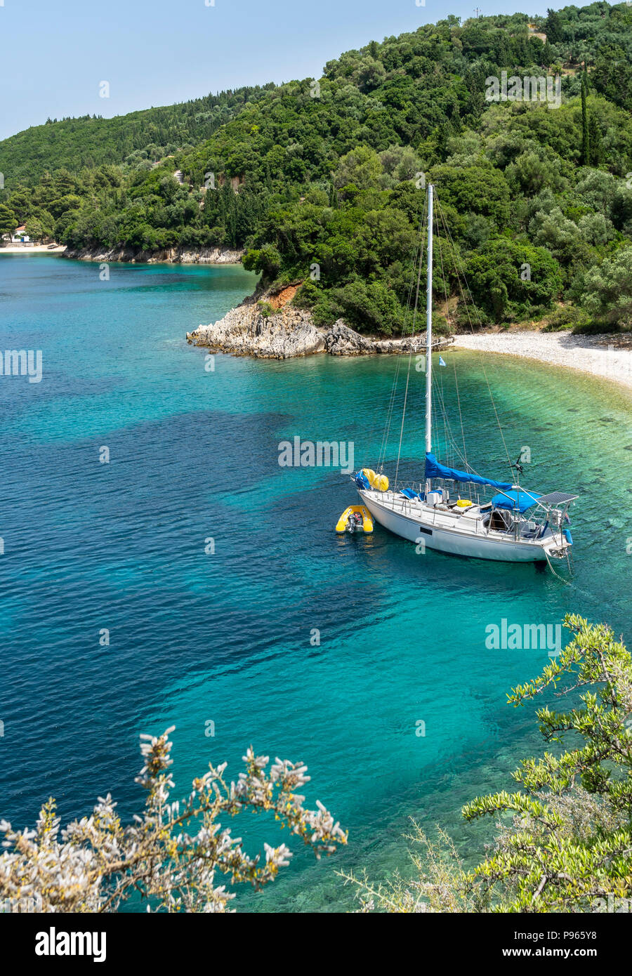 Yacht at anchor in one of the many small  coves near Kioni on the North East coast of the  island of Ithaca, Ionian Sea, Greece - Stock Image