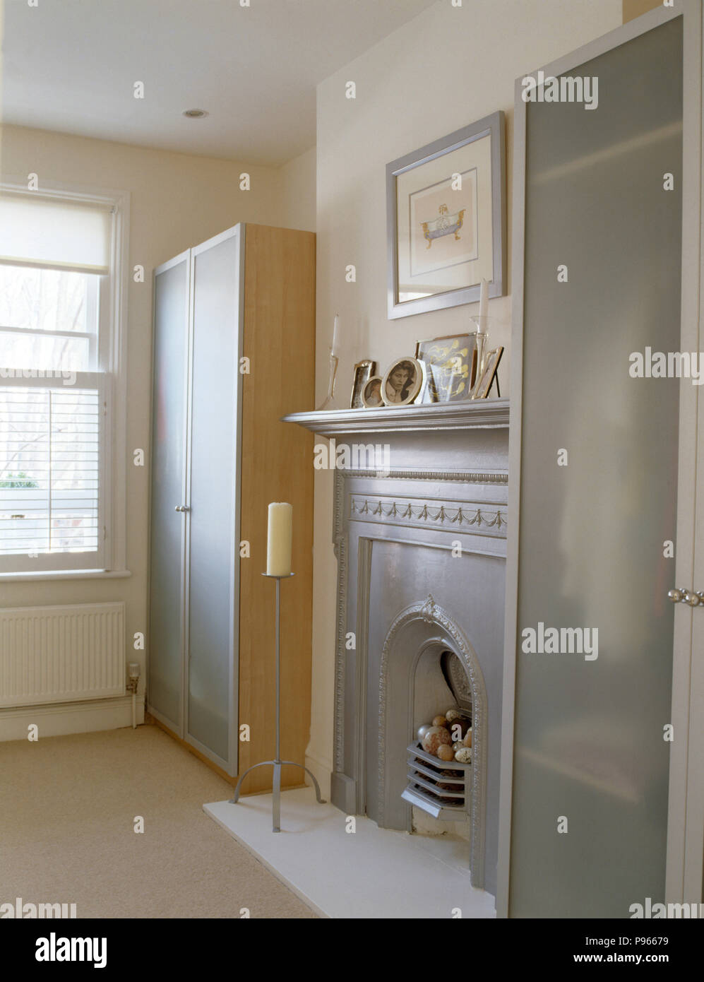 Silver Painted Fireplace Between Modern Wardrobes With Opaque Glass