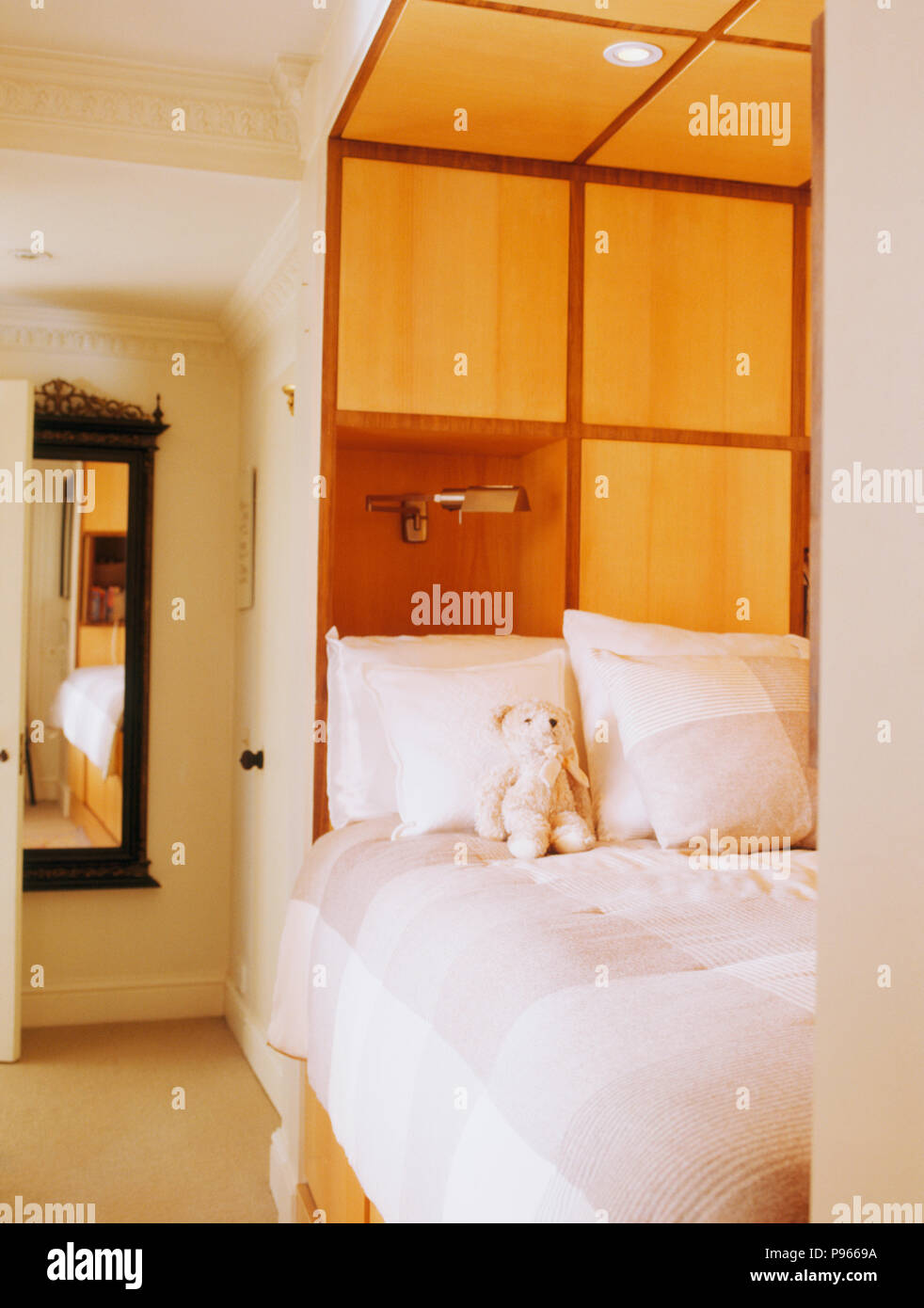 Concealed Storage Above Fitted Bed In Compact Modern Bedroom Stock Photo Alamy