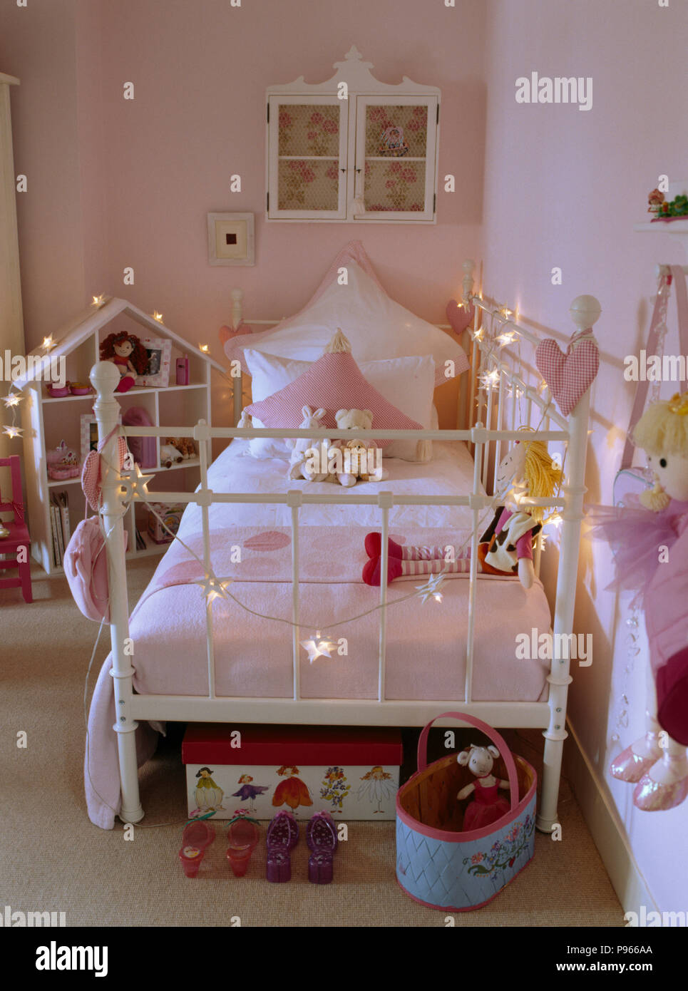 Star-shaped lights on white metal day-bed in child\'s pale ...