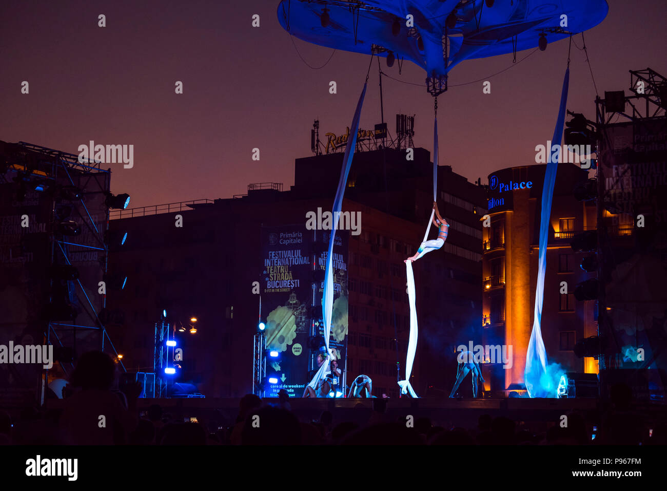 Bucharest, ROMANIA - July 14 2018: Sonics in Wish performance at Street Theater Festival. Blindfolded dancers climbing the rope and performing aerial  - Stock Image