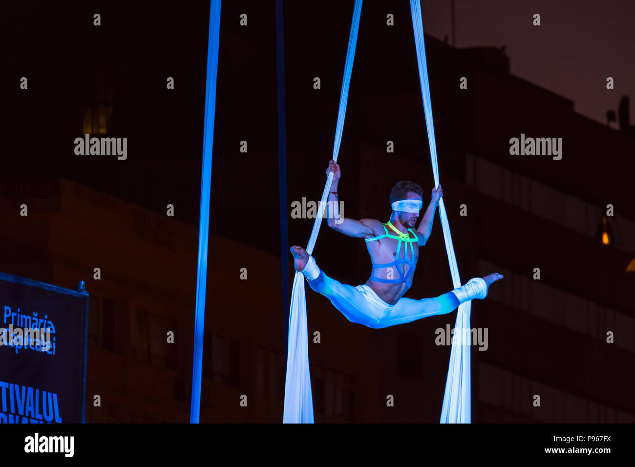 Bucharest, ROMANIA - July 14 2018: Blindfolded dancer from the Sonics in Wish performance at Street Theater Festival in Bucharest. Aerial acrobatics p - Stock Image