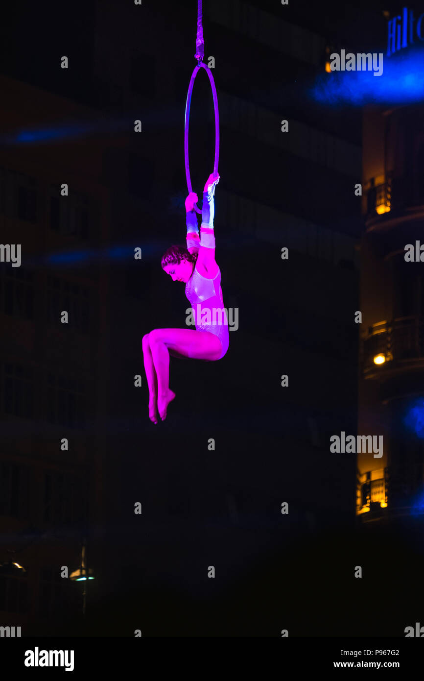 Bucharest, ROMANIA - July 14 2018: Beginning of the Sonics in Wish performance at Street Theater Festival. Aerial acrobatics performed on overturned s Stock Photo