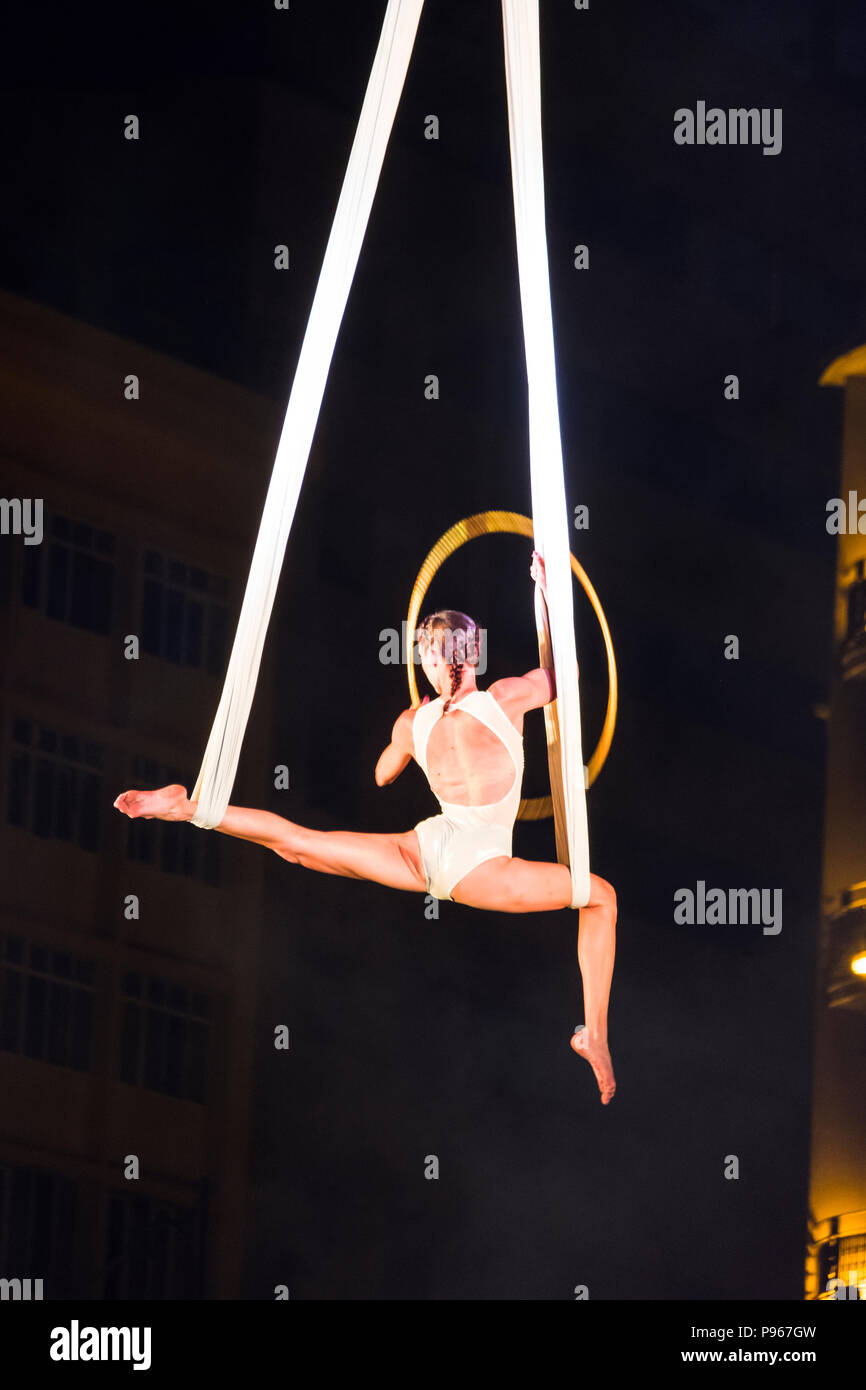 Bucharest, ROMANIA - July 14 2018: Beginning of the Sonics in Wish performance at Street Theater Festival. Aerial acrobatics performed on overturned s - Stock Image