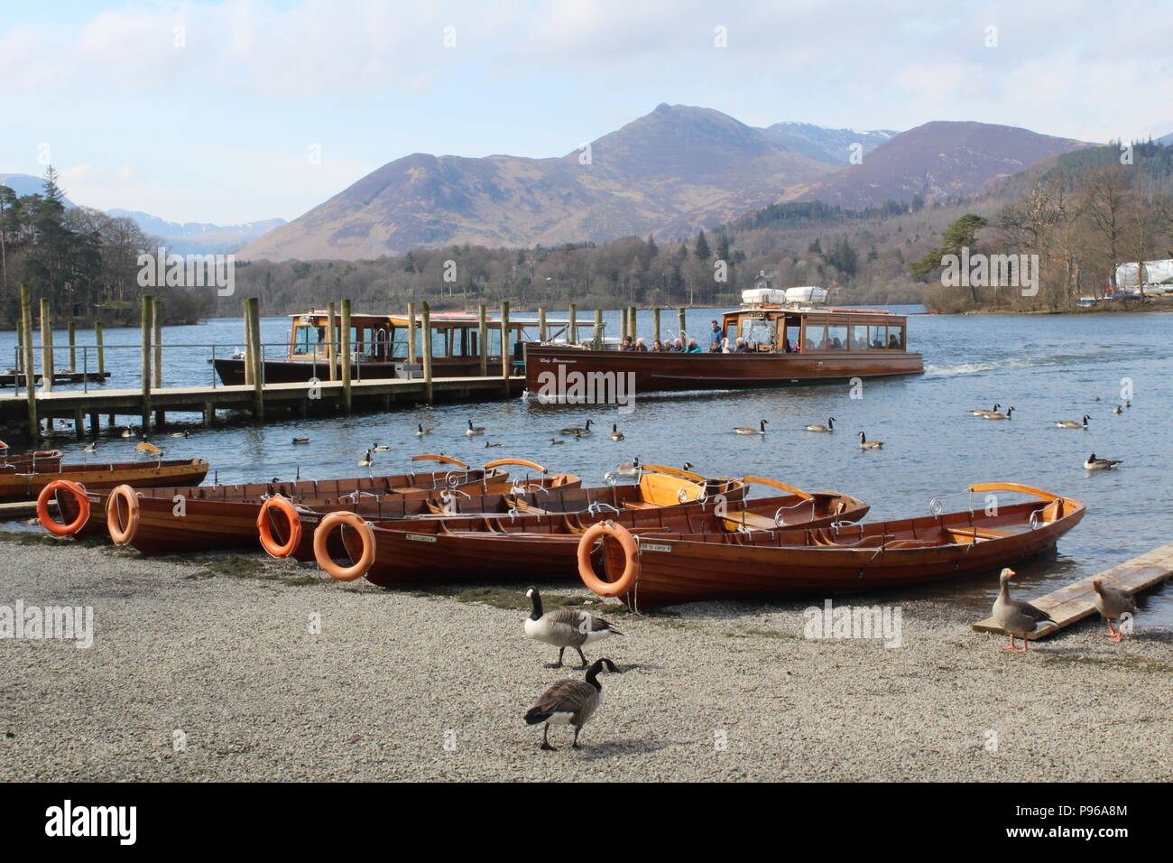 Motor launch Lady Derwentwater at landing stage at Keswick with passengers - Stock Image