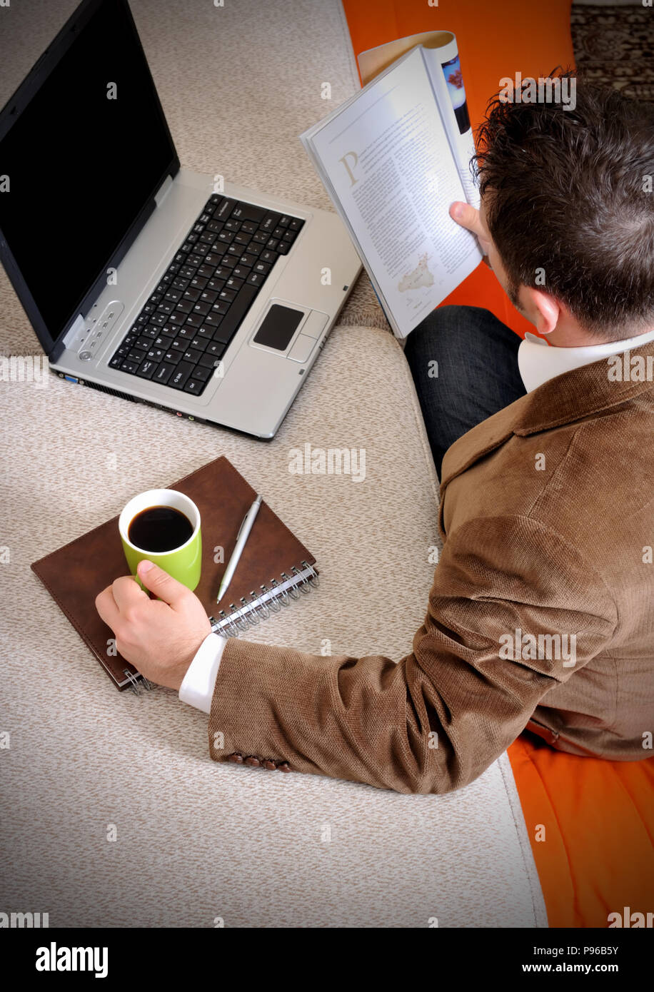 Businessman is reserching at home - Stock Image