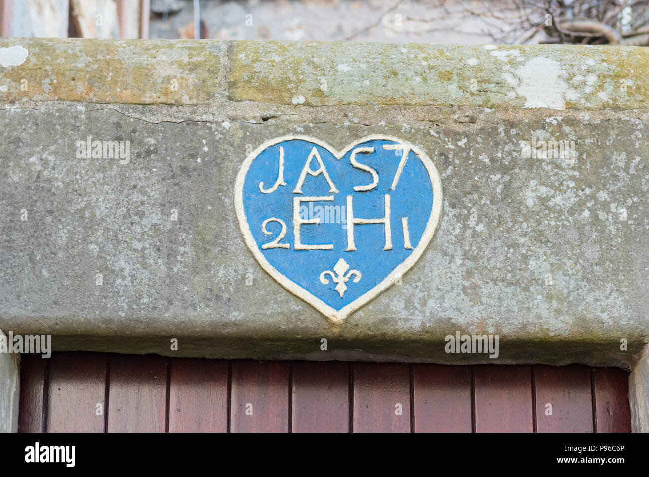 Scottish marriage lintel - carved initials and date (1721) above door, St Andrews, Scotland, UK - Stock Image