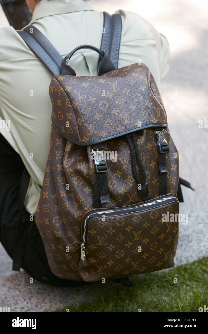 d428fe40c7 MILAN - JUNE 18: Man with Louis Vuitton brown backpack before Giorgio Armani  fashion show