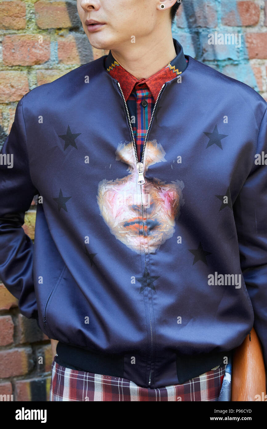 Milan June 18 Man With Blue Satin Bomber Jacket With Face Design