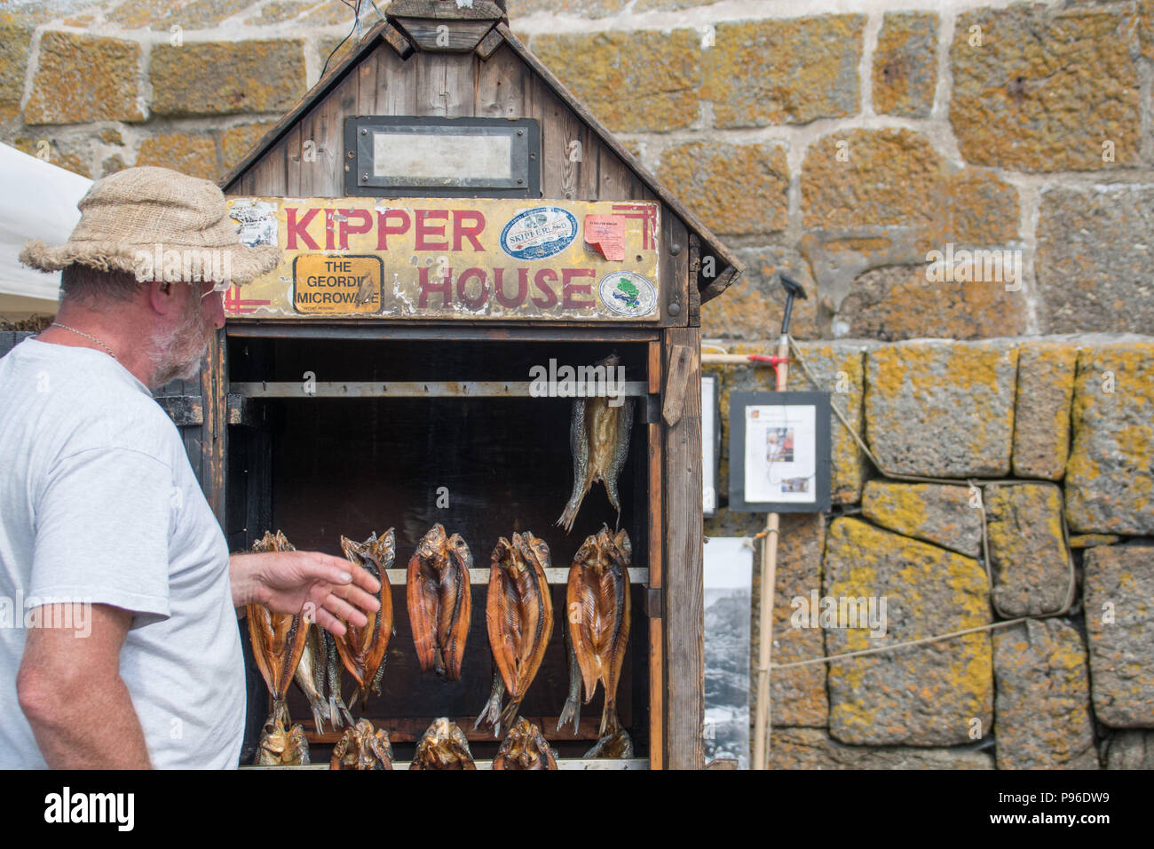Smoked Kippers on sale in a small wooden smoking house - Stock Image