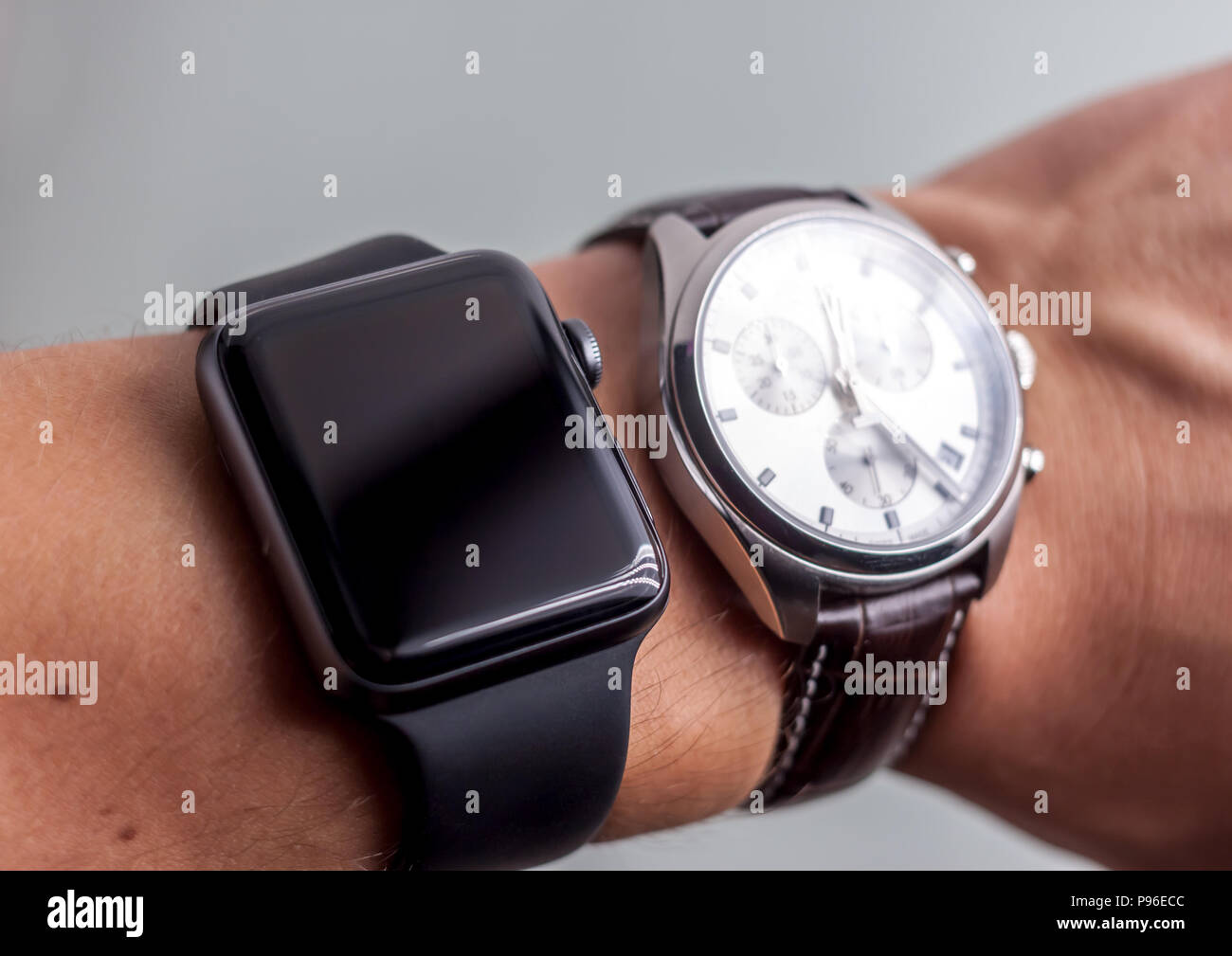 smart and classic wathes on wrist - Stock Image