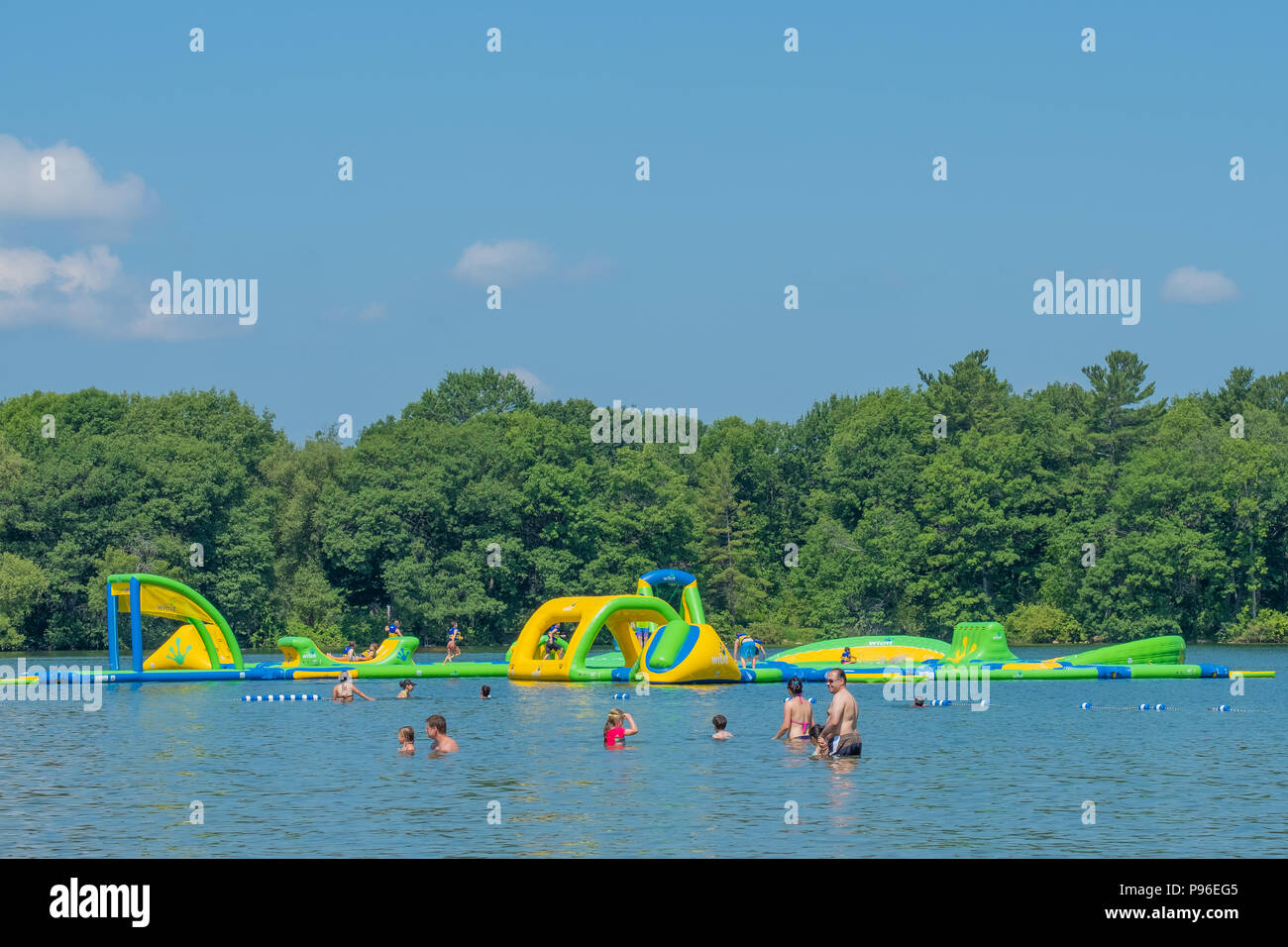 Families enjoy a cooling swim in Lake Couchiching during an extended heatwave in Orillia Ontario Canada. - Stock Image