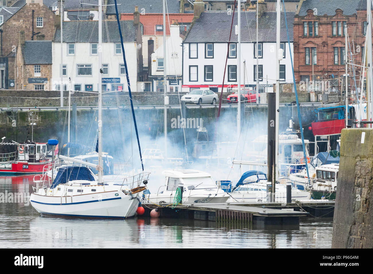 white smoke coming from just started boat diesel engine - Stock Image