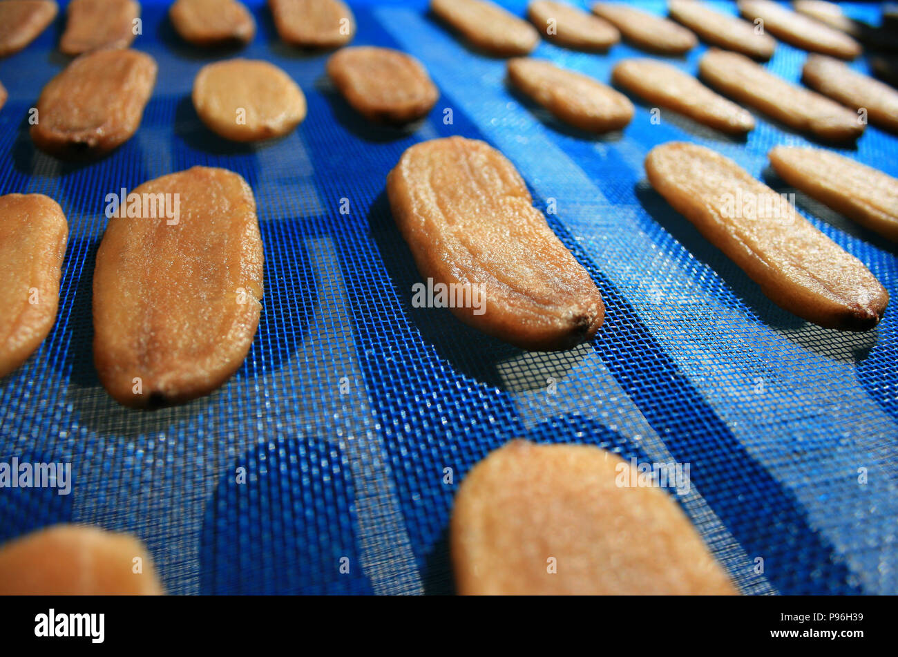 Dried banana on blue mesh, Dried fruit Stock Photo