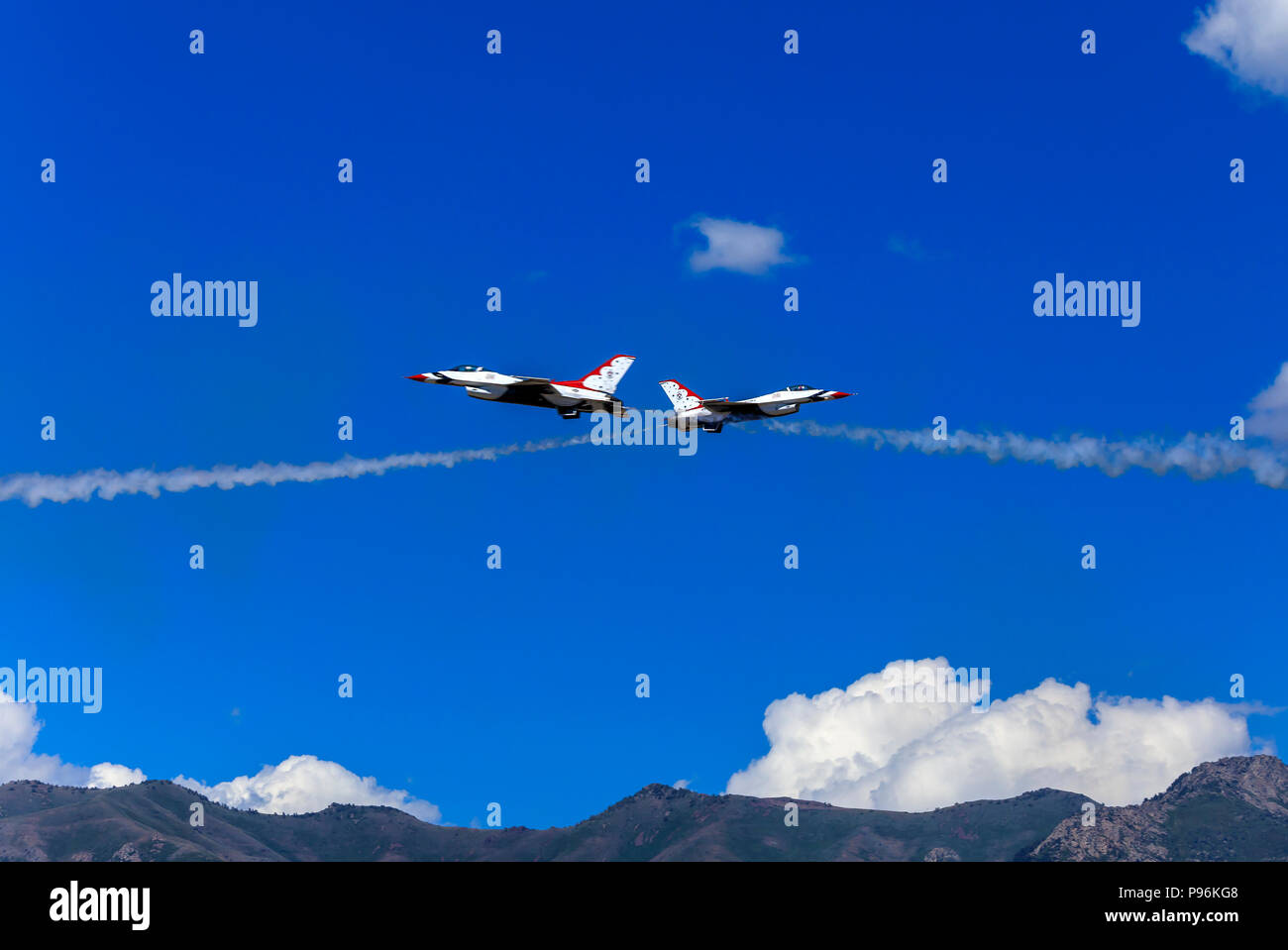 In this shot two of the aircraft of the U. S. Air Force Air Demonstration Squadron (Thunderbirds) perform the 'Knife Edge' maneuver at Hill AFB, Utah. - Stock Image