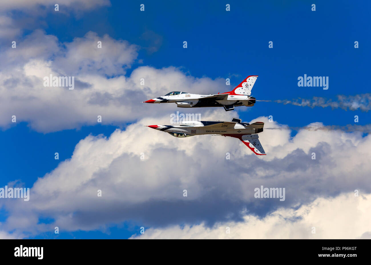 The No. 5 and No. 6 aircraft of the U. S. Air Force Air Demonstration Squadron (Thunderbirds) perform the 'Reflection Pass' maneuver at Hill AFB Utah. - Stock Image