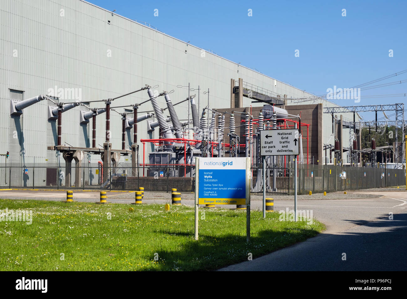 Danger sign for substation behind Wylfa Nuclear Power Station which is no longer generating electricity. Cemaes, Isle of Anglesey, Wales, UK, Britain, - Stock Image