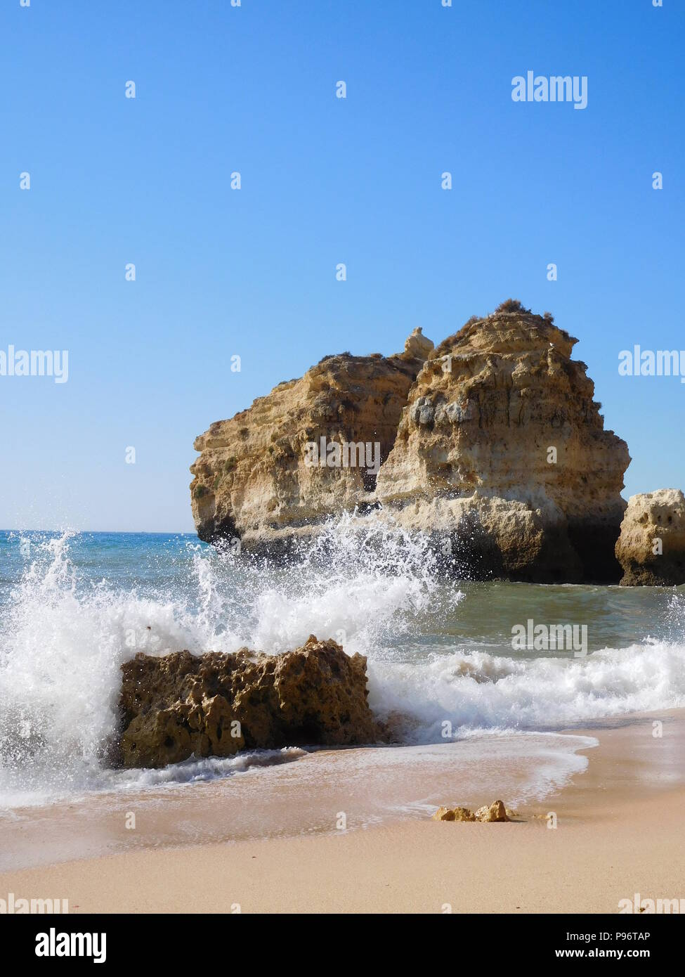 Waves at the beach in Portugal on a sunny day - Stock Image