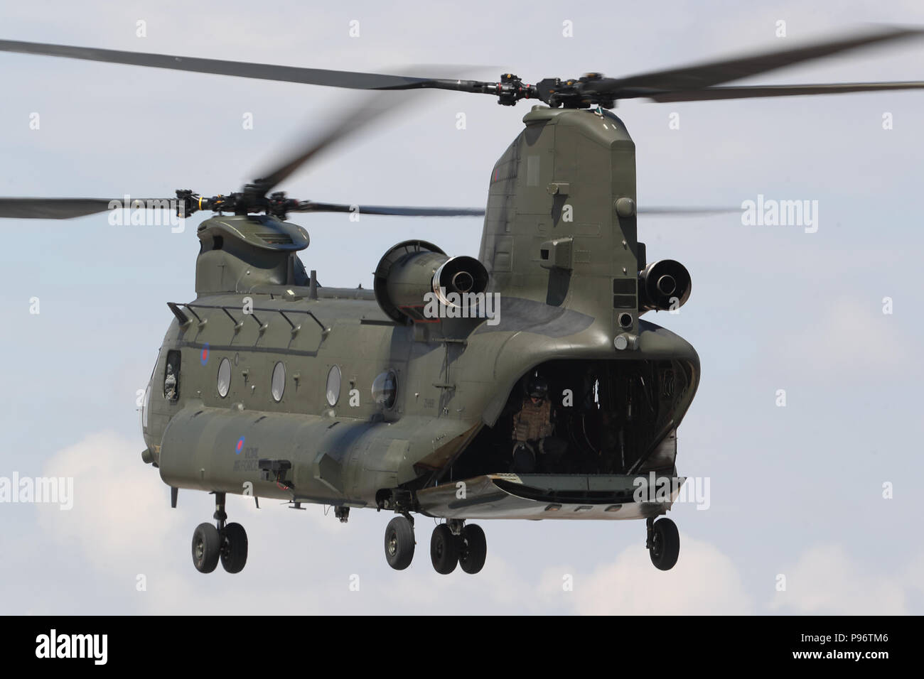 A Boeing CH-47 Chinook shows its versatility at the Royal International Air Tattoo 2018 at RAF Fairford, UK - Stock Image