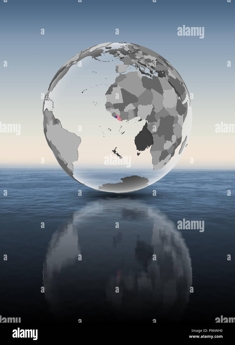Liberia with flag on translucent globe above water. 3D illustration. - Stock Image
