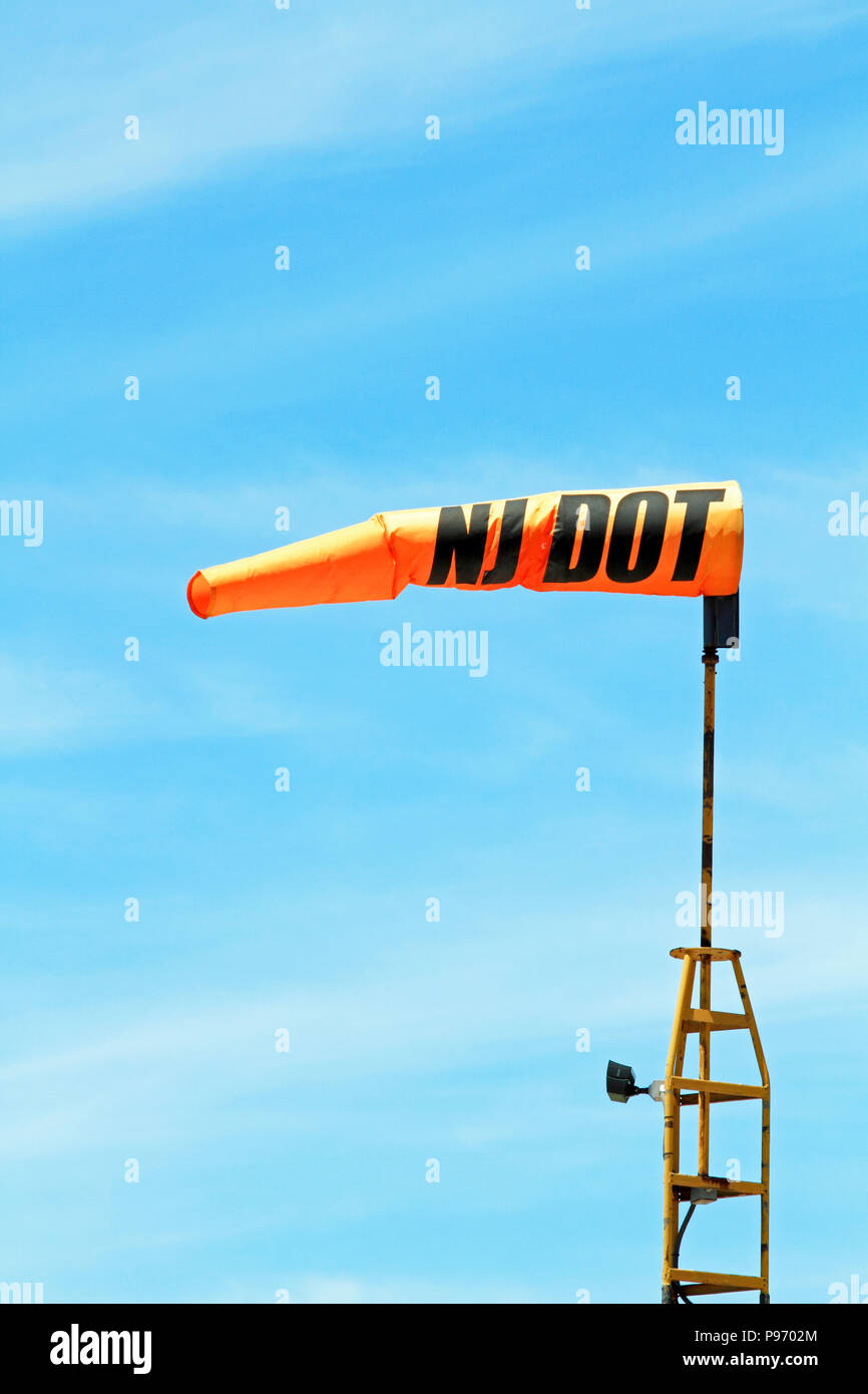 A wind sock at the Lincoln Park airport, Lincoln Park, New Jersey, USA. Winsocks provide basic information concerning wind direction and speed. - Stock Image