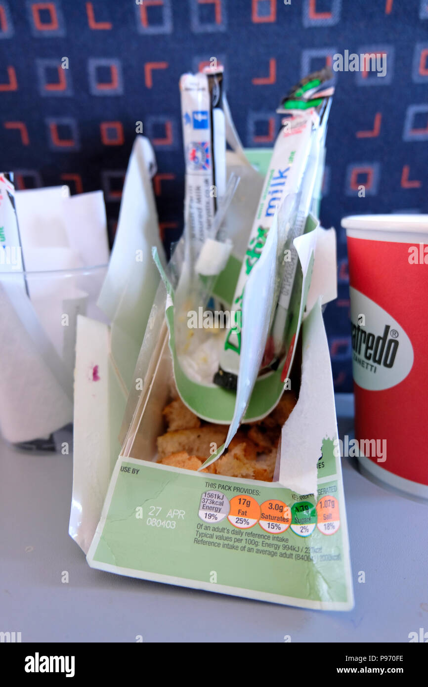 Used food and drink containers on tray on plane - Stock Image